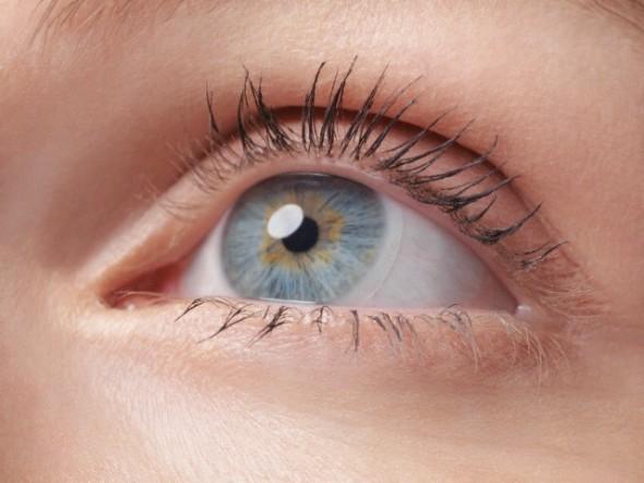 Closeup of a woman's blue eye wearing contact lens
